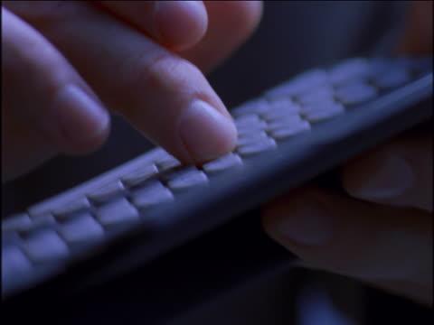 Man typing on an electronic organizer