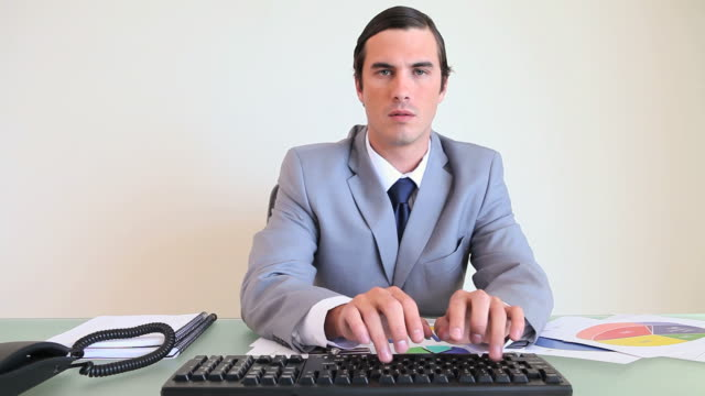 Man typing on his computer