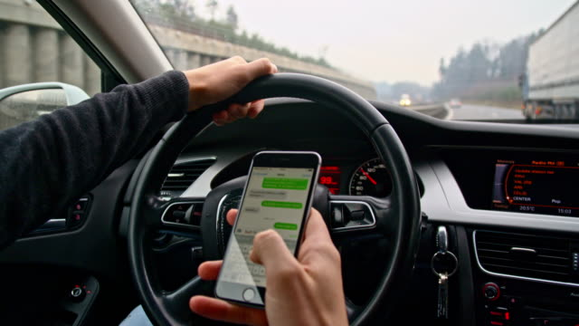 slo mo man typing sms while driving - text messaging stock videos & royalty-free footage