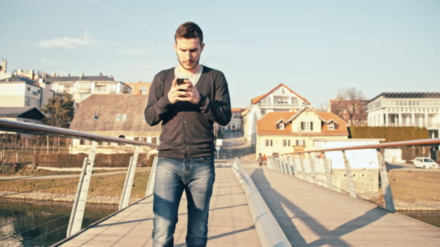 MS TS Man Typing SMS While Walking On Bridge