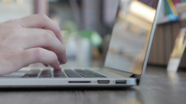 man typing text on the laptop keyboard - touch screen stock videos and b-roll footage