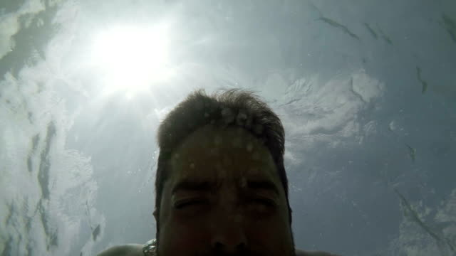 Man underwater. Slow motion