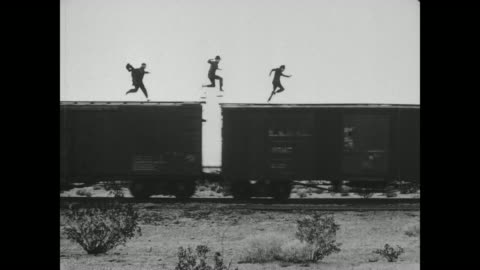 1918 man (fatty arbuckle) unhooks the caboose from the train and thinks he has escaped from the men chasing him, but the train reverses and bumps into the caboose - rooftop stock videos & royalty-free footage