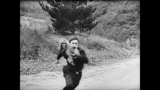 1921 Man (Buster Keaton) unknowingly lassos a bear and runs away in fear