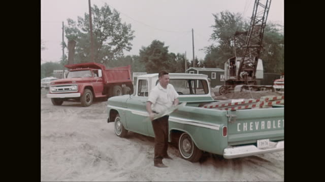 ms man unloading construction equipment from pick up truck / united states - chevrolet stock videos & royalty-free footage