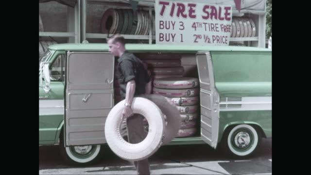 vídeos y material grabado en eventos de stock de ms man unloading tires from van / united states - escritura occidental