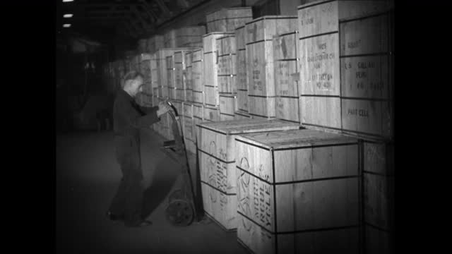 ws man unloads wooden crate from hand truck in warehouse; 1952 - 1952 stock videos & royalty-free footage