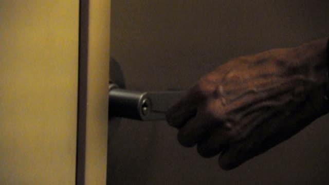 CU Man unlocking door and entering, Los Angeles, California, USA