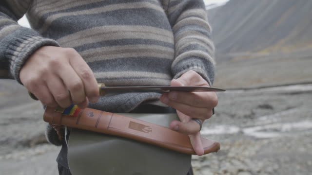 man unsheathes knife, slow motion - survival stock videos and b-roll footage