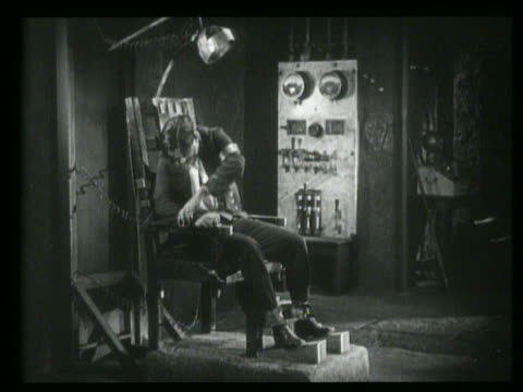 b/w man untying himself from electric chair - electric chair stock videos & royalty-free footage