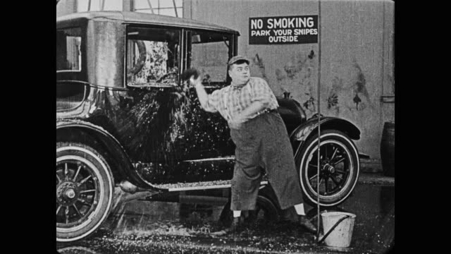1920 man (fatty arbuckle), upset because man (buster keaton) unknowingly dirties the car that he just washed, throws a wet sponge at keaton - cleaning sponge stock videos & royalty-free footage