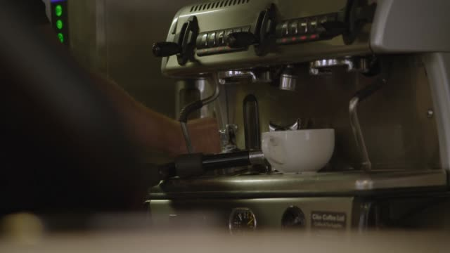 a man uses a coffee grinder - preparation stock videos & royalty-free footage