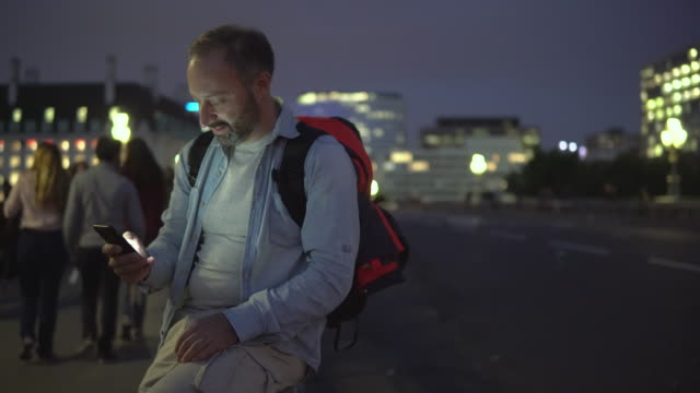 Man uses a smartphone on the street