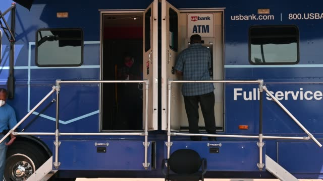 a man uses an atm at a mobile us bank on july 8 2020 in minneapolis minnesota the temporary bank is set up in the parking lot of a location that was... - financial item stock videos & royalty-free footage