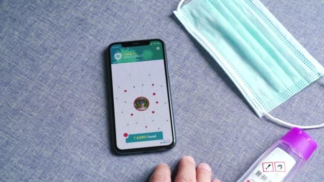 man uses covid-19 coronavirus tracing app - contact tracing stock videos & royalty-free footage