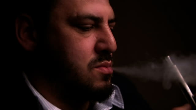 Man uses electronic cigarette