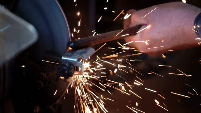 man uses grinder in workshop in slow motion - metal industry stock videos & royalty-free footage