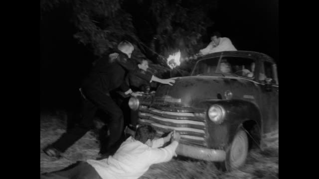 1968 Man uses gun and flame to fight off zombies attack as a couple attempt escape in car