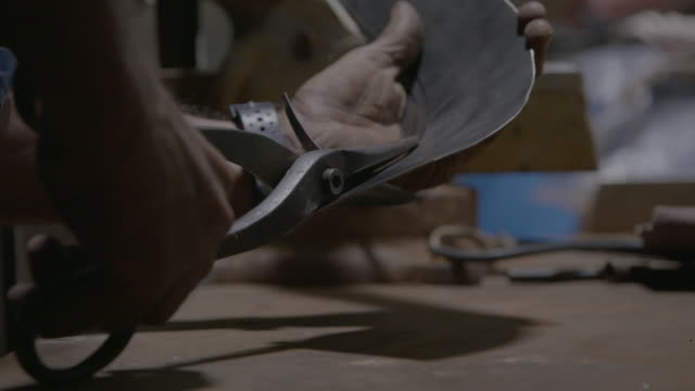 man uses hawk billed snips to cut bent sheet metal - metal stock videos & royalty-free footage