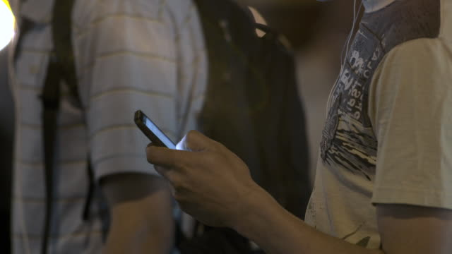 man uses his smartphone for a text at night - online messaging stock videos and b-roll footage