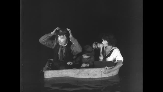 1921 man (buster keaton) uses tap on bathtub lifeboat to make hat drink for son - small stock videos and b-roll footage