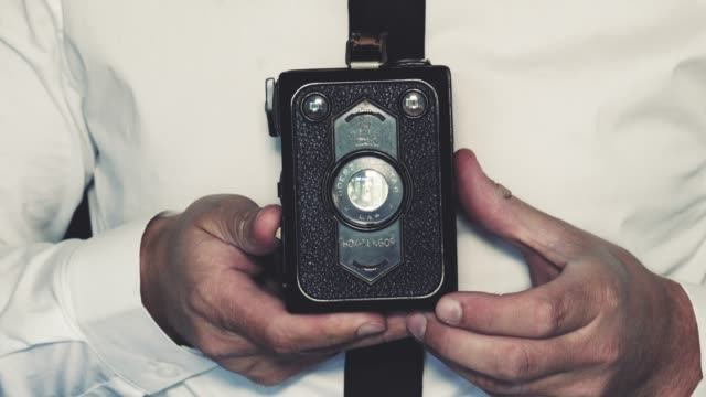 man uses vintage box camera - photographic equipment stock videos & royalty-free footage