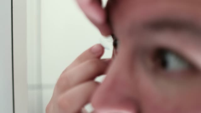 man using a contact lens - contact lens stock videos and b-roll footage