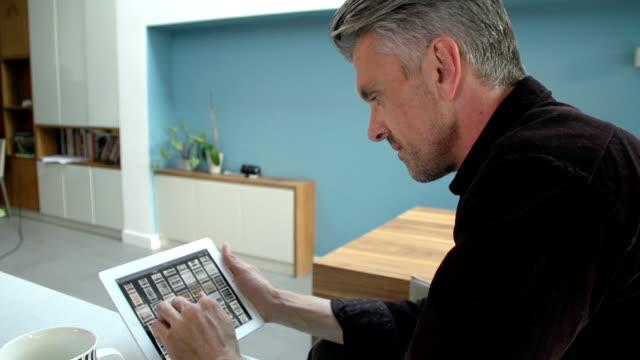 HD: Man Using A Digital Tablet At Home
