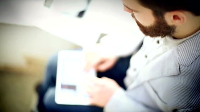 man using a digital tablet. - obscured face stock videos & royalty-free footage
