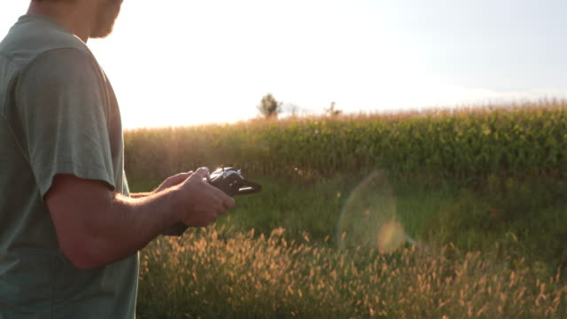 Man using a Drone for Agriculture at Sunset