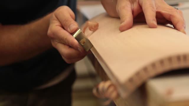 cu man using a hand tool to plane a piece of wood. - skicklighet bildbanksvideor och videomaterial från bakom kulisserna