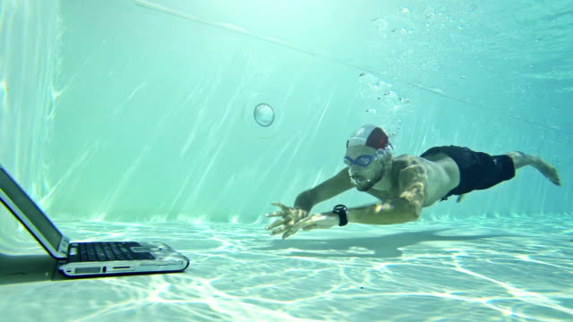 man using a laptop underwater - sleep apnea stock videos and b-roll footage