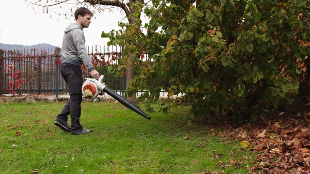 man using a leaf blower on the lawn - heap stock videos & royalty-free footage