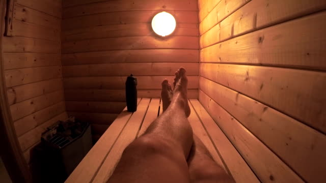 man using a sauna pov - sauna stock videos & royalty-free footage