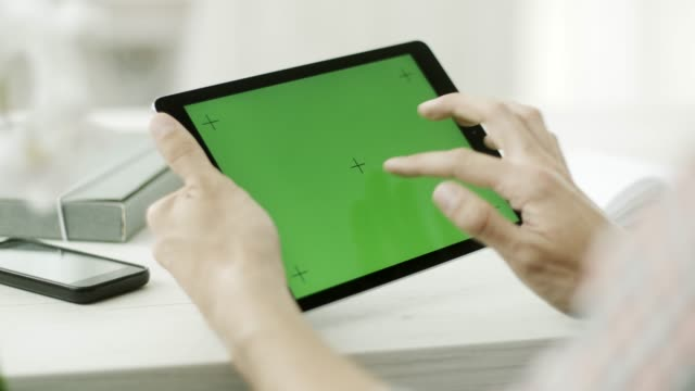 a man using a tablet with a green screen - caucasico video stock e b–roll