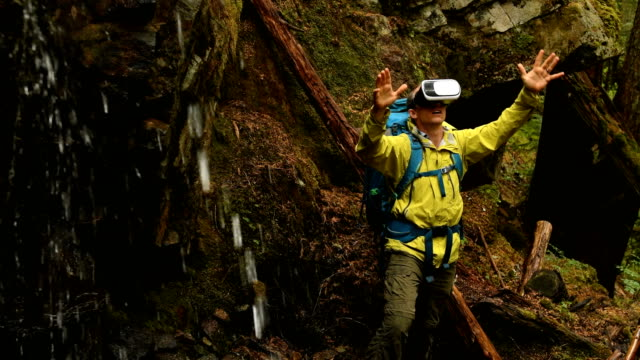 Man using a VR Headset in the great outdoors