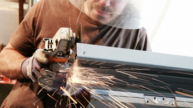 man using an angle grinder - protective mask workwear stock videos and b-roll footage