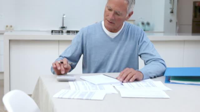 Man using calculator to do home finances