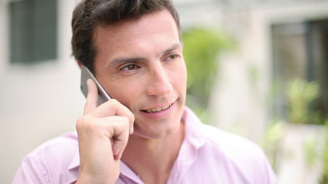 man using cell phone outdoors, portrait - only mature men stock videos & royalty-free footage