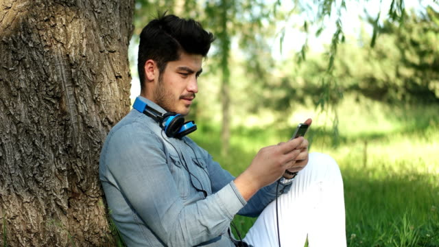 man using cellphone outdoors - bench stock videos & royalty-free footage
