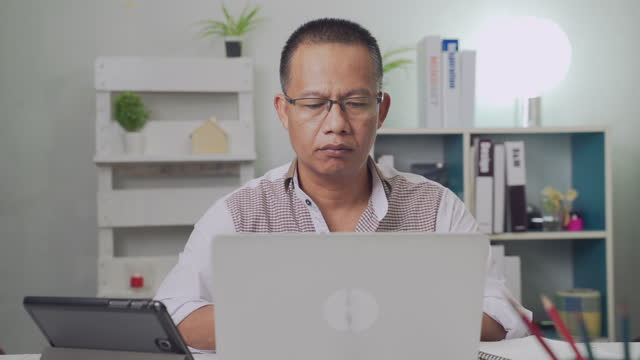 man using computer to work from home and communication online internet with business team in home,social distancing - hot desking stock videos & royalty-free footage