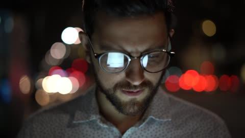 man using digital tablet at night - dedication stock videos & royalty-free footage