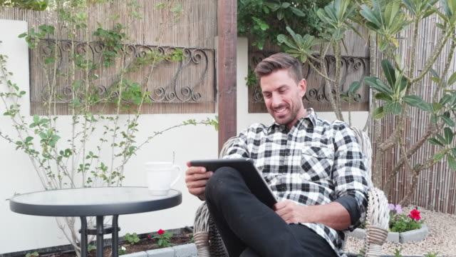 man using digital tablet to communicate with his friends over video call - tartan stock videos & royalty-free footage