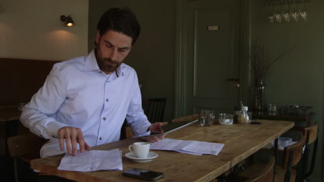 man using digital tablet - food and drink industry stock videos & royalty-free footage