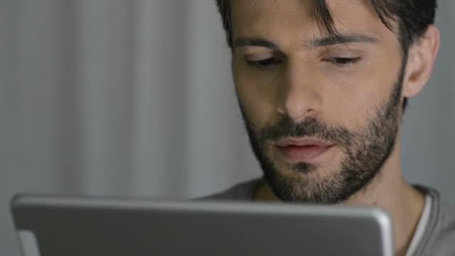 Man using digital tablet