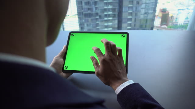 man using digital tablet with green screen hold in hands - using digital tablet stock videos & royalty-free footage