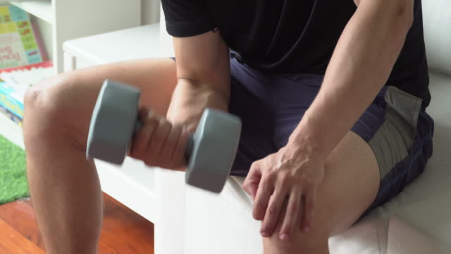 man using dumbbell doing workout at home - bicep stock videos and b-roll footage