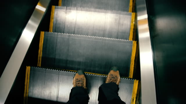pov man using escalator - walking point of view stock videos & royalty-free footage