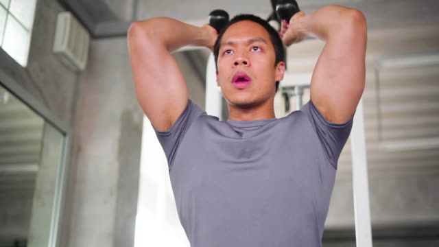 man using exercise equipment in gym - sports training stock videos & royalty-free footage