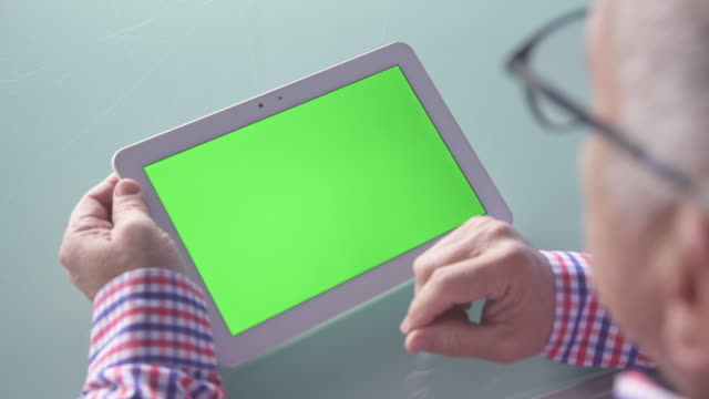 man using green screen tablet - looking over shoulder stock videos & royalty-free footage